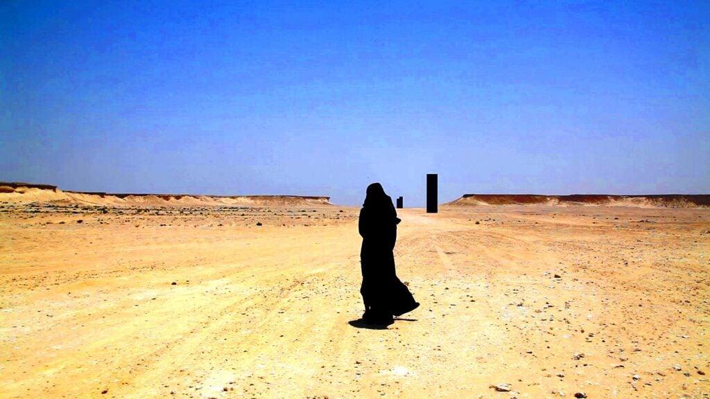 Image still from Suzannah Mirghani short film Hind's Dream taken at Richard Serra sculptures in Qatar